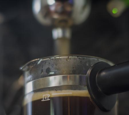 Espresso coffee machine on shallow background