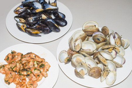 3 grill seafood dishes. Shrimps salad, mussels and clams isolated on white