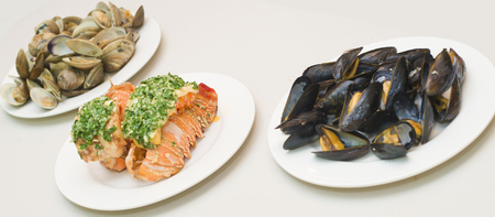3 grill seafood dishes. lobster, mussels and clams isolated on white
