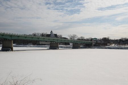 New England Historic bridge on frozen river in winter season in Maine