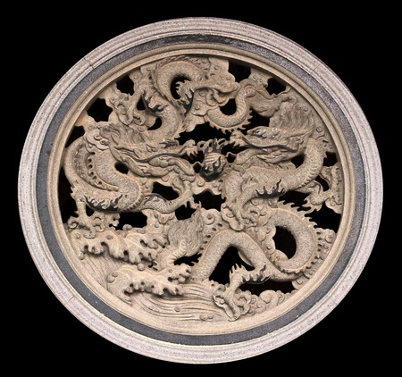 Dragon carved in China temple on a black background.