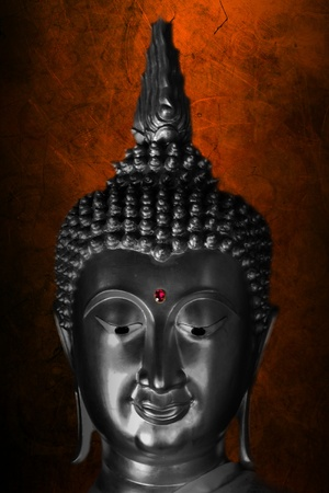 silver buddha statue on grunge background  Stock Photo