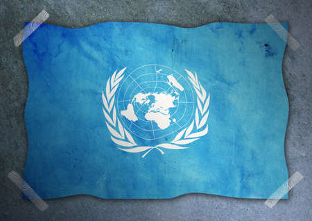 united nations: United Nations flag on cement wall  Stock Photo