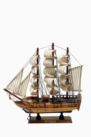rudder ship: Wooden ship toy model, isolated on white background  Stock Photo