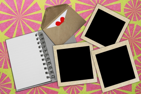 cement wall background with notebook and photo frame  Stock Photo