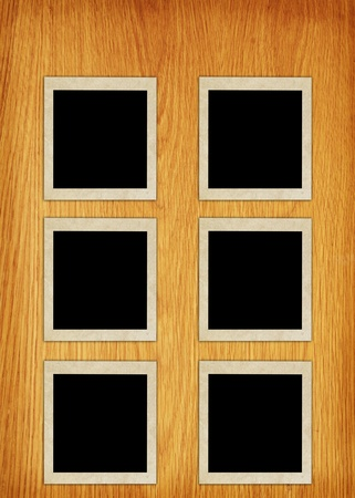 confines: photo frames on wood background  Stock Photo