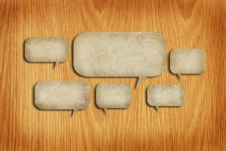 grunge paper speech bubbles on wood background Stock Photo - 13787584
