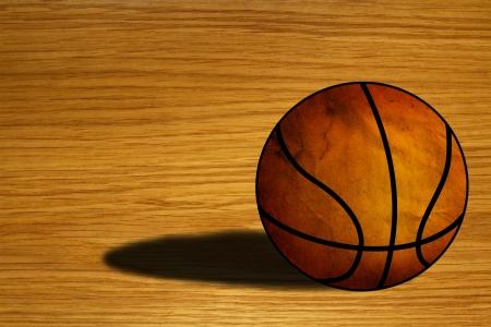 Basket-ball sur le plancher en bois