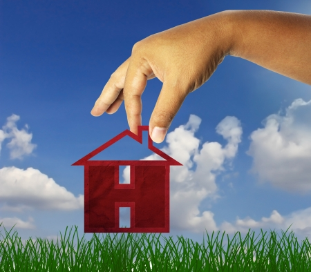hand holding  icon house ; real estate business concept photo