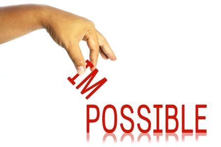 Main et le mot impossible, impossible en possible; concept d'entreprise