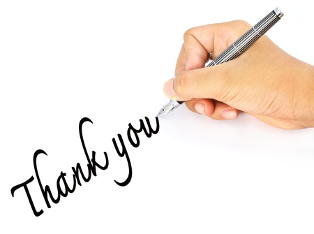 Hand writes the word thank you Stock Photo