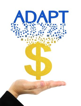 adapt: adapt word and dollar symbol on hand  Stock Photo