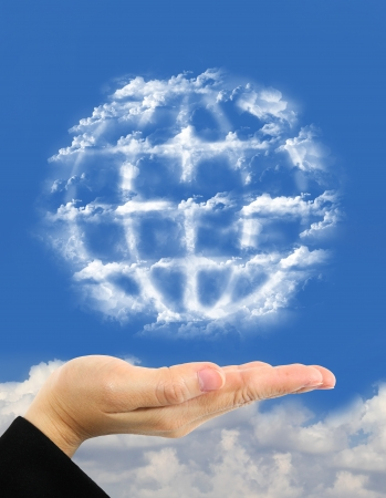 earth symbol made of clouds  over hand photo