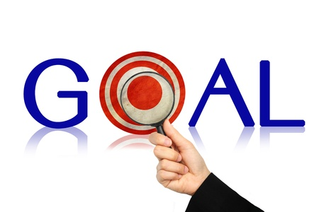 Goals word and Magnifying glass ,Target concept. photo