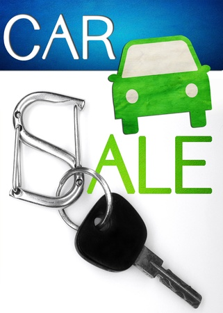 key isolated on white as a concept of car sale photo