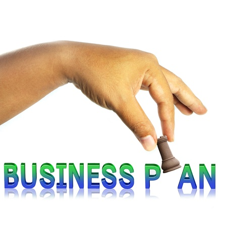 hand with chess figure making move ;business plan concept