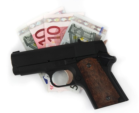 Gun and money on the white background Stock Photo