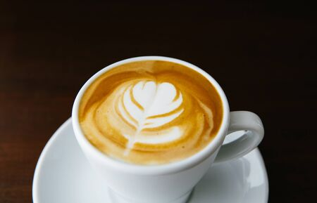 Latte art. Barista coffee cup Stock Photo