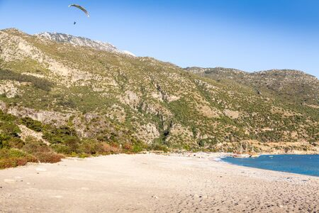 Paragliding over the mountains and sea Stock Photo