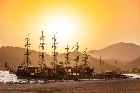 Sailing old ships on sunset