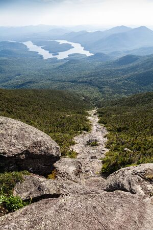 Rocks and Adirondack Mountains view Фото со стока