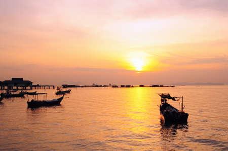 fishing village: sunrise in fishing village Stock Photo