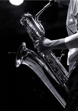 sax player on stage during jazz festival photo