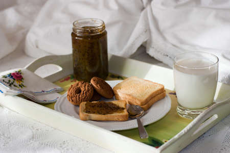 bred: breakfast served in bed, on the  tray bred. biscuits, jam and milk