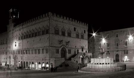 priori: night shot of fontana maggiore and palazzo dei priori, perugia, italy