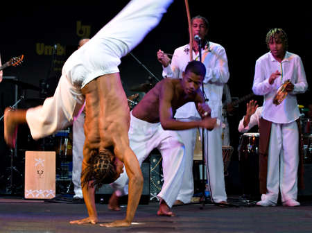 rhythms: PERUGIA, ITALY - JULY 12, 2010 - Projecto Axé (music, dance and capoeira) from Brazil on stage at Umbria Jazz Festival - July 12, 2010 in Perugia, Italy Editorial
