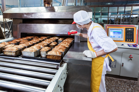 processors: Worker in the food production factory Editorial