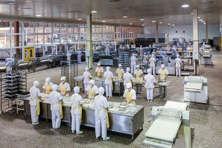 Workers in the food production factory