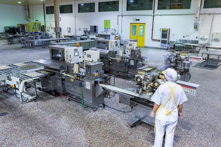 experimento: Los trabajadores de la f�brica de producci�n de alimentos Editorial