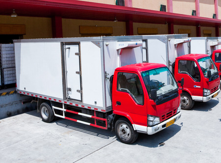 Food production factory and delivery trucks