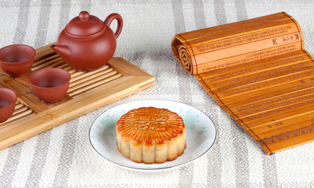 semisweet: Cakes and tea set on the table Stock Photo
