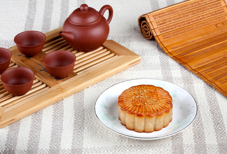 semisweet: Cake and tea set on the table Stock Photo