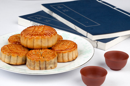 semisweet: Moon Cake and book Stock Photo