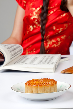 semisweet: moon cake with a girl reading book Stock Photo
