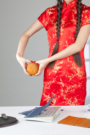 semisweet: A Chinese girl holds a moon cake Stock Photo