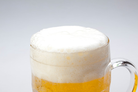 foam: mug fresh beer with cap of foam