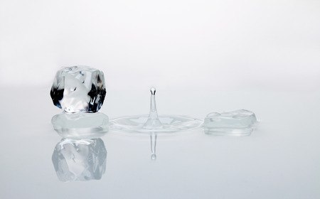 water splash with ice cubes on white background photo