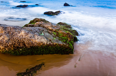 Sanya beach with rock
