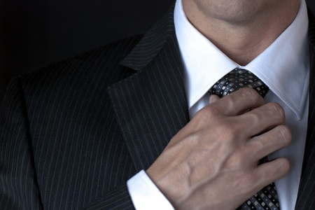 necktie: Businessman Adjusting Tie Stock Photo