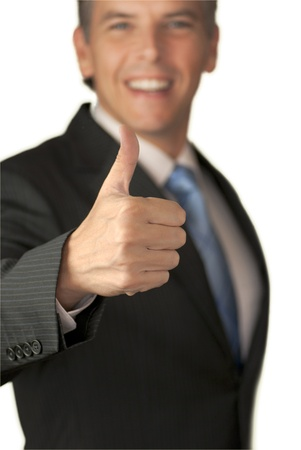 Smiling Businessman Offers Thumbs Up To Camera  photo