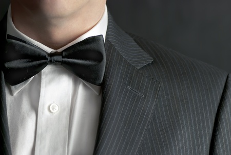 formal attire: A close-up shot of a man wearing a tux.