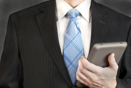 A close-up shot of a businessman with a tablet computer. photo