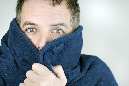 Close-up of a man bundled up in his housecoat.
