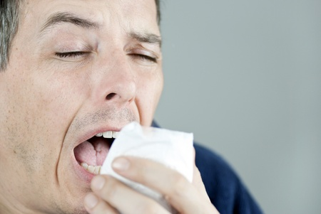 Close-up of a man sneezing. photo