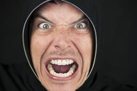Close-up of an furious man looking to camera.