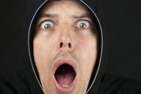 Close-up of a shocked man looking to camera. Stock Photo - 9585213